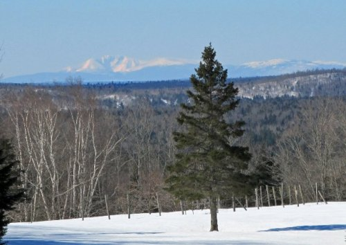 Mount Katahdin can be seen in the distance. The photo was taken from Maine Route 163 near Haystack Mountain on the road between Ashland and Presque Isle, Maine. (According to Google Maps, the road is also known as the Presque Isle Road, Haystack Road, Main Street as it goes though Mapleton, Maine, and then the Mapleton Road as it nears Presque Isle.) Kelly McInnis, a classmate of mine from Ashland Community High School Class of (mumble, mumble), took the photo. It must have been an incredibly beautiful day when this photo was taken since Mount Katahdin, the tallest mountain in Maine and the official end of the Appalachian Trail, is more than 100 miles away as the crow flies. Photo by Kelly McInnis